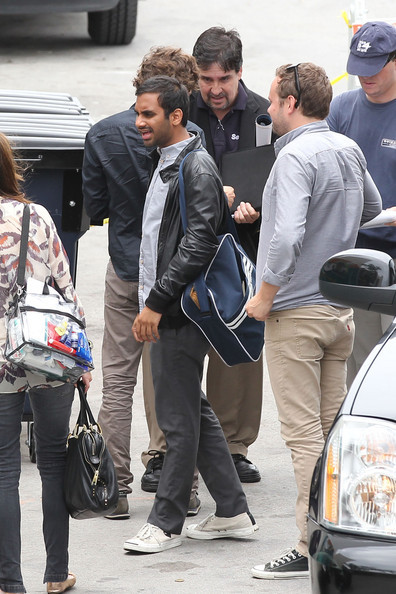 Aziz Ansari wearing a pair of Comme des Garcons Play Jack Purcell sneakers ($125)…I kind of die for him…