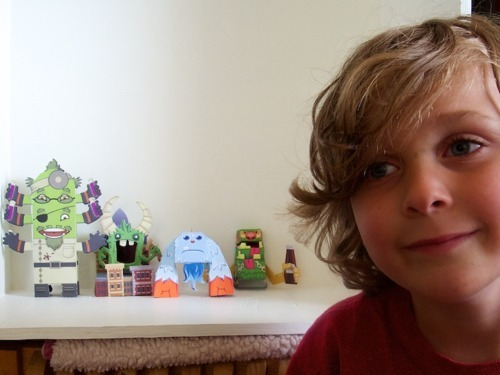 "'Our friend Finn and the Papertoy Monsters in his ""Pokeman Four!""' We'd be careful, Finn. Those monsters look a little too well-behaved. We bet they're planning something naughty.  (Fab snap courtesy of Societe des Monstres. Merci, guys!)"