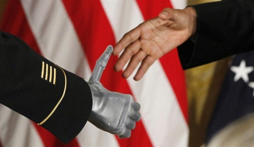 inothernews:  President  Barack Obama shakes the prosthetic hand of U.S. Army Sgt. First Class  Leroy Arthur Petry of Santa Fe, New Mexico, who received the Medal of Honor  for his valor in Afghanistan in a ceremony in the East Room of the White  House, July 12, 2011. Petry lost his right hand as he picked up and tossed aside a  live grenade during a 2008 firefight in Afghanistan, sparing the lives  of his fellow Army Rangers.  (Photo: Charles Dharapak / AP via MSNBC.com)