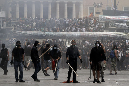 ontologicalterrorist:  Demonstrators confront police in front of the Greek parliament  Photograph: Alkis Konstantinidis/AFP/Getty Images