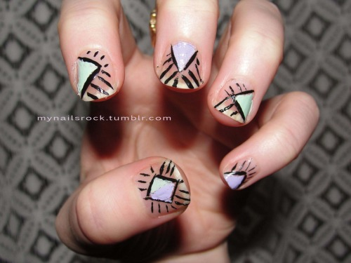 Triangle lines.  Here are some triangles with some lines.  My black nail art polish is getting kind of gloopy so it isn't as crisp as I would have liked.  I see a new one in my future… Polish used: American Apparel L'Esprit & Office
