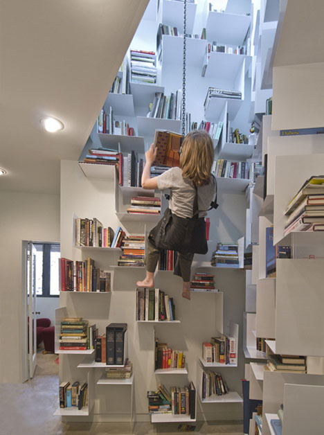 Incredible Home Bookcase Climbs 40 Feet of Interior Walls via Dornob Extreme book storage! While I adore this, I do I have to admit I draw the line at harnessing myself up to grab that old copy of Orwell's 1984.