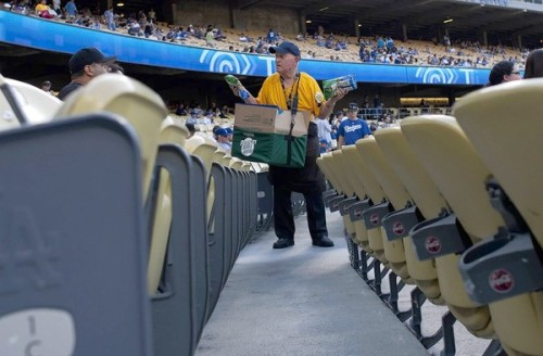 "Still pitching peanuts at Dodger Stadium: Just shy of 80, Ronnie Nelsen has been a Dodgers vendor for 53 years, focusing mainly on peanuts. An inspiration to teammates and fans, he hasn't missed a home game in nine years. Photo: ""I look at life this way,"" Ronnie Nelsen says. ""I'm doing this for my health, I'm burning weight off and I'm seeing people and enjoying life."" Credit: Gina Ferazzi / Los Angeles Times"