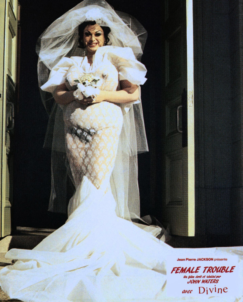 Divine in a peekaboo wedding gown complete with fake lady bits in John Waters' Female Trouble, 1974.