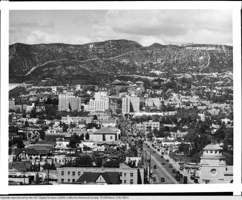 "L.A.'s iconic Hollywood sign was dedicated on this day in 1923. Until 1949, it actually read ""Hollywoodland"" in reference to the housing development in the sign's immediate vicinity. This photo from the USC Libraries' TICOR/Pierce collection shows the sign circa 1925."