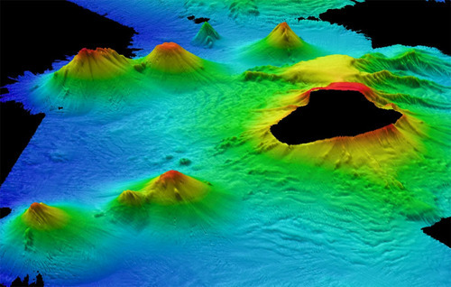 poptech:  Image-wise: Massive underwater volcano discovery  In the first ever-survey of its kind, a chain of massive volcanoes that rise up to 1.86 miles were discovered lurking beneath Antarctic waters near the South Sandwich Islands in the remote Atlantic Ocean.   (Image: British Atlantic Survey via Discovery News)    holy moly.