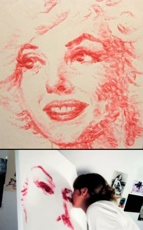 photojojo:  Artist Natalie Irish painted this Marilyn Monroe portrait with her lips! Marilyn's face is entirely made up of lipstick kisses. Extra: Watch this vid on her process. Marilyn Monroe Portrait Made Out of Lipstick Kisses