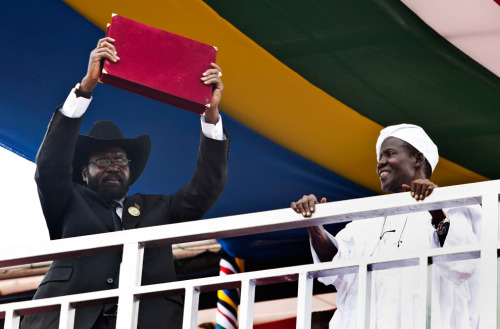 greaterthanlapsed:  South Sudan President Salva Kiir lifts South Sudan's new constitution above the crowds of people attending an independence ceremony in Juba, South Sudan, on July 9, 2011. South Sudan celebrated its first day as an independent nation Saturday, raising its flag for the first time before tens of thousands of cheering citizens elated to reach the end of a 50-year struggle. (Andrew Burton/AP)South Sudan: A new nation rises - The Big Picture - Boston.com