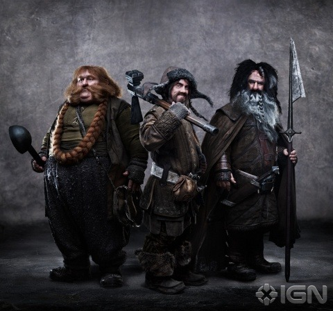 (via Exclusive: New Hobbit Photo - Here's a first look at Bofur, Bombur and Bifur / IGN.com)  (L-r) Stephen Hunter as Bombur, James Nesbitt as Bofur and William Kircher as Bifur in New Line Cinema's and MGM's fantasy adventure The Hobbit: An Unexpected Journey, a Warner Bros. Pictures release.While most of the Company of Thorin Oakensheild is related to the royal and noble line of Durin, Bofur, his brother Bombur and their cousin Bifur most definitely are … not. Born and bred in the West, descendants of coal miners and iron workers, they have joined the Quest for the Lonely Mountain partly to seek their fortune and partly because they were told the beer was free.  I have questions. 1) Born and bred in the West, descendants of coal miners and iron workers Based on this and the costumes, what… what are we actually going for here? I'm concerned. 2) Bombur (far left) is very wide and Weeble-shaped with dark grey trousers, a dull green shirt, an open vest and and a vacant stare. He is not wearing Noble Dwarven Gear; his weapon appears to be a large black ladle. From this angle, I can't really tell. He has a long red beard pulled back behind his ears and then braided back over his chest like a necklace. WHY? 3) In the middle, Bofur at least gets some Noble Dwarven Arm Bracers. Also, some kind of axhammer propped on his shoulder. And furry boots and a low-slung belt. Does his cap have ear flaps? 4) On the right, Bifur is comparatively shaman-esque, drawing from a completely different visual type. He's holding a tall spear and has a short sword on a belt. His huge shaggy hair is black on top with a huge grey-white beard with two braids. There's something in his hair, but at this resolution, I can't tell if it's a feather or a braid or just a grey streak. Maybe two of them. I'm not sure. Also, bracers and a cloak, since he apparently knows how to dress for a quest. What is he doing with these chuckleheads? Do he and Dori drown their family-related woes at the Blue Mountain bars? Are they secretly hoping to boot them all into a chasm? 5) BEARD NECKLACE?