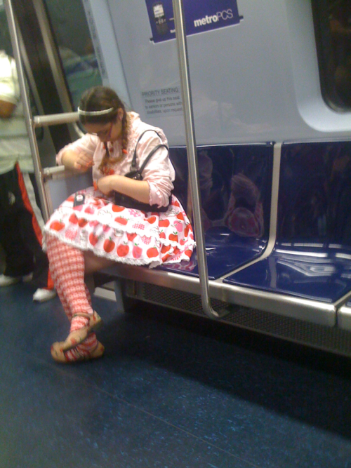 Recently rode the subway with Strawberry Shortcake. Say what you will, she's got style in spades.