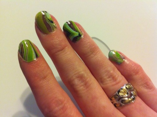 Beautylish user Alicia B.'s water marbled nails totally look like those old school marbles we used to play with in school! Check out this tutorial to get your own water marbled nails!