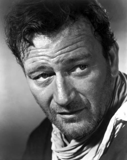 John Wayne, an iconic figure in American entertainment history.