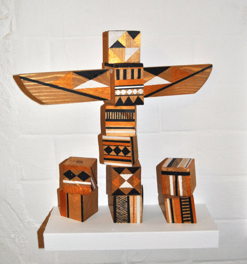 This wooden totem is one of the pieces I made for my exhibition called Trekx. It was inspired by the ceramics I came across during my trip to Cyprus. Every block was hand cut by myself (hence the wonkyness). This is something I definitely want to explore in the future, there's something very therapeutic about wood craft.