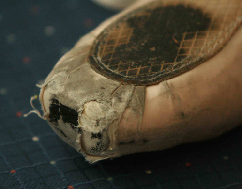 Battered. Shot of a beautiful, battered pointe shoe…