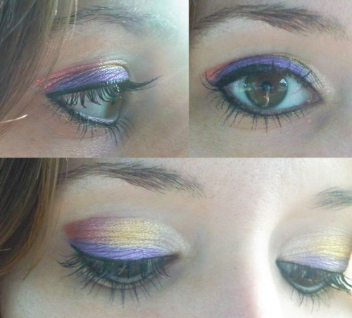 redwolfbeach:  Today's Theme: Sunset in Rio Used: NYX Jumbo Eye Pencil in Cottage Cheese, NYX Loose Pearl Eyeshadows in Fanta Pearl and Yellow Pearl, Urban Decay Peacock Pallet Flash (Purple), Physicians Formula Shimmer Strips in Vegas Strip (Top Strip-White), e.l.f. waterproof eyeliner pen in Black, Ulta eyeliner in Gold and Mabelline's The Falsies mascara.  (This was my first time using The Falsies and I was greatly disappointed.  It did not go on well, the brush was a disaster and it dried as hard as plastic.  I will not be using again!)