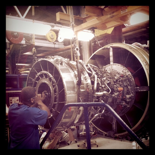Shooting at our #Aviation plant in Cincinnati, OH today. #Engine assembly technicians DeJuan Blumberg and Michael McClain at work on a #CFM 56-7 engine. #GE #avgeek (Taken with Instagram at GE Aviation Bldg 800)