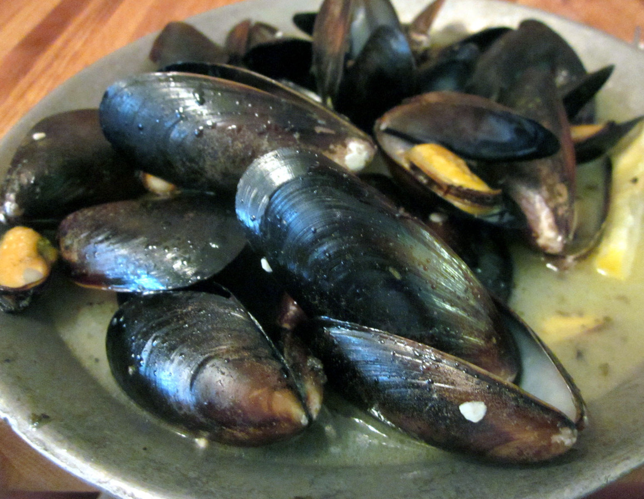 Garlic Steamed Clams at MJ's Raw Bar and Grille in New Bern, NC There was so much juice to soak up that I had to ask for more rolls. Lots of fun to eat. My shirt did not seem to enjoy it as much as I did, though.