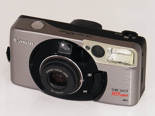 Canon sure shot 105 zoom s date camera A 1997 model from Canon's phenomenally successful Sure Shot range,  this  compact film camera - known as the Prima Super 105 in continental   Europe and Autoboy Luna 105 in Japan - has an impressive spec. * Lens: 38-105mm zoom, f/3.8-9.9. (6 elements in 6 groups, including 2 aspherical pieces for superb sharpness).* Focus: Three-point AI active auto-focus from 0.6m to infinity.* Viewfinder: Real image zooming, with framelines and LED ready and low-light warnings.* Auto-loading, advancing and rewinding of DX-coded 35mm (25-3200 ISO).* Small LCD with frame counter and mode icons.* Shutter-speed from 2 seconds - 1/550s depending on mode.*   Auto-flash, with red-eye, forced fill, slow synch, and forced off  mode.  Range of 6m at ISO 100. (GN of 14). Recharge in 6 seconds.* Real-time (RT) mode with shutter lag of just 0.03 seconds.* Self-timer.* Tripod socket.* Power: CR123A lithium battery.* Dimensions: 123x64x46mm* Weight: 245g Also available with Date function. This top of the range model was superseded by the 120 Classic. *** googled images for now, card reader's busted can't upload the actuals :(( reach me at 090526590-six.six