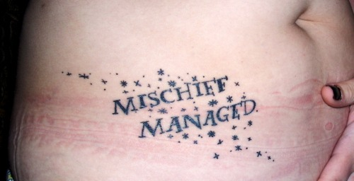"This is my ""Mischief Managed"" tattoo. Obviously I am a Harry Potter nerd. I wanted something unique (or at least somewhat unique) in a sea of HP geek tattoos. I got this on my right abdomen/hip about 3 weeks ago to symbolize the end of an era and to show my pride. I've been an HP geek for 11 years now and it all ends today. Tattoo designed and inked by Inky at Electric Chair Tattoo Clio, MI."