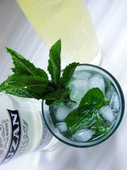 Last night I made MOJITOS! So minty and tasty. + 12 fresh spearmint leaves+ 1/2 lime+ 2 tablespoons simple syrup (equal amounts sugar and water heated until sugar dissolves, cooled) or 4 teaspoons sugar+ 1 1/2 ounces light rum+ Club soda+ Lime wedge and mint sprig, for garnish  In a tall glass, muddle or mash together the mint leaves and lime. Add the simple syrup or sugar and fill the glass with ice. Add the rum and top with club soda, stir well. Garnish with a lime wedge and a sprig of mint.  Recipe: Food Network  Photo credit: Lush Lady