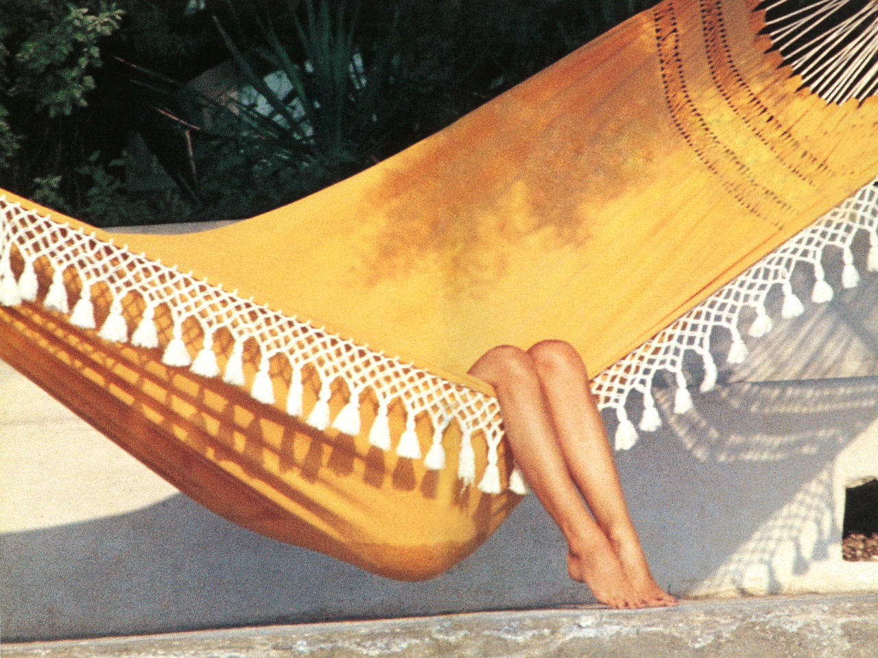 S is for St. Tropez  Brigitte Bardot on a hammock in St. Tropez shot by Slim Aarons. This is one of the many visually arresting photographs found in In The Spirit of St. Tropez.