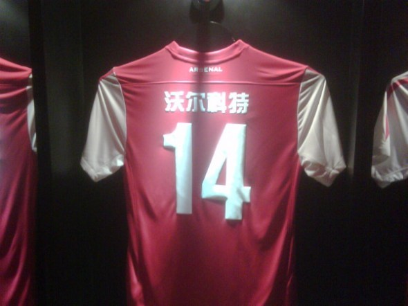 "cheekychip:  If you ever wondered what Theo Walcott's Arsenal jersey looks like in China, here you go!  loosely translates to ""Whirling Dervish Who Rarely Completes Task"" (*not really, but Gunner fans are already nodding in agreement. DON'T LIE.)"