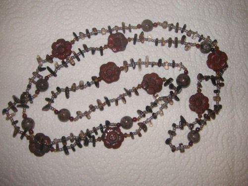 "Double length string (approx 52"") with smoky quartz chips, schist rounds, red jasper flowers and tiny garnet rounds."