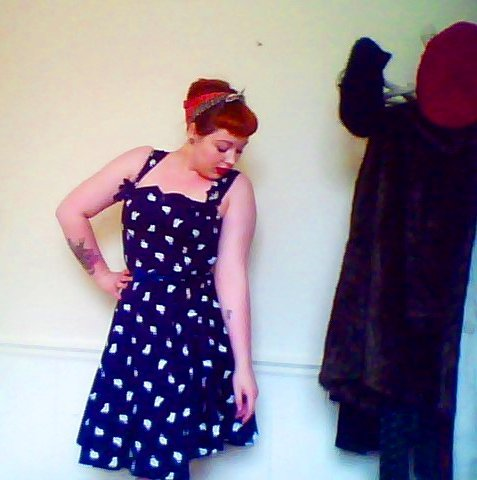 fuckyeahchubbyfashion:  I love wearing 1940s-60s style dresses - I feel so confident in them, way more than when I used to dress in baggy, shapeless clothes. I'm UK Size 16-18 and measure 40-29-40, so the nipped in waists of mid-century styles really show off the big curves I used to try so hard to hide, but now embrace! Headscarf - Celia Birtwell (gift) Navy Bunny Print Swing Dress - People Tree (£75 - but now on sale for £35!) You can't see in the photo, but I wear this dress with navy t-bar wedge heels. Lots of love to all you fierce fatshionistas! frass submitted  I love this dress! LOVE LOVE LOVE