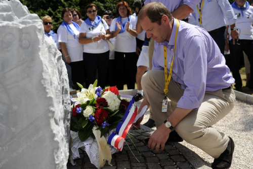 Tour de France director Christian Prudhomme lays down a bunch of flowers on a stela built in memory of Italian cyclist Fabio Casartelli in the Portet d'Aspet pass near Luchon, south of France, prior to the start of the 168,5 km and fourteenth stage of the 2011 Tour de France cycling race run between Saint-Gaudens and Plateau de Beille, southern France on July 16, 2011. Casartelli died in 1995 after crashing in the Portet d'Aspet pass. AFP PHOTO / LIONEL BONAVENTURE (via Tour De France Director Christian Prudhomme Lays Down A Bunch Of Flowers On A Stela Built In Memory Of Italian Cyclist - Yahoo! Sports Photos)