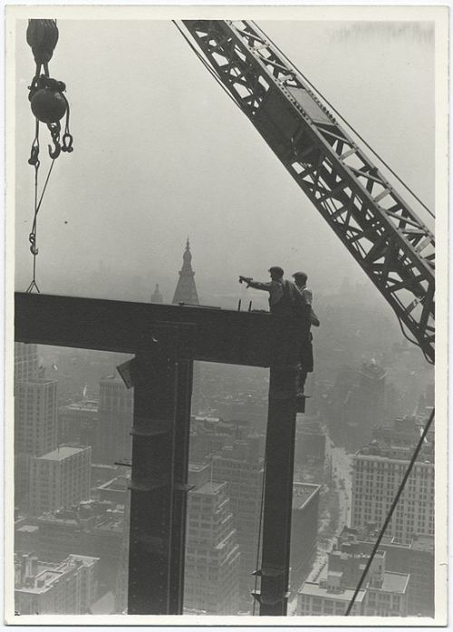 blackandwtf:  1931 Two construction workers at the corner of two steel beams point to left while constructing the Empire State building. This year marks the 80th anniversary of the Empire State building. The Empire State building was the world's tallest building from 1931-1971.