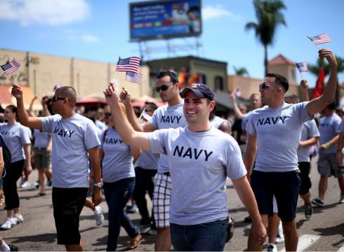 "Troops March In Gay Pride Parade In San Diego  The Huffington Post reports:  About 200 active-duty troops and veterans wearing T-shirts advertising their branch of service marched Saturday in San Diego's gay pride parade with American flags and rainbow banners, marking what is believed to be the first time a military contingent has participated in such an event in the U.S.Many of the active-duty troops said they were moved to come out because it is time to end the military's ban on openly gay troops. The march comes a day after a federal appeals court reinstated ""don't ask, don't tell"" but with a caveat that prevents the government from investigating or penalizing anyone who is openly gay.National Guard member Nichole Herrera, 31, said she didn't think twice about marching, even though the policy is back on the books. She said she was ""choked up"" several times as she walked down a main thoroughfare in San Diego, a major Navy port.""This is one of the proudest days in my life. It's time for it (the policy) to be gone,"" Herrera said. ""I'm a soldier no matter what, regardless of my sexual orientation.""The crowd roared as the group waving military flags and holding placards identifying their military branch walked past the thousands.Every branch of service was represented Saturday, including the Coast Guard. Marines and sailors ran out carrying their branch's flags over their heads. One Marine stopped to pose with two towering bikini-clad blondes in stiletto-heeled boots.Onlookers stepped into the parade route to salute them. One man in a rainbow colored shirt waved his feather boa and yelled ""Hooah!"" the military battle cry.The national Servicemembers Legal Defense Network – representing gay and lesbian active-duty military personnel – informed organizer Sean Sala that they are warning members that it is still a risk to come out as long as ""don't ask, don't tell"" is on the books.Sala, a former Navy operations specialist, said it's time for the gay and lesbian community to stop hiding in fear.""This is not in any way a violation of military policy and it's time for the country to move on – plain and simple,"" he said.Rolling slowly behind the 200 service members was a green half-ton military truck with the banner ""Taking pride in our LGBT service men and women."" Speakers on the truck blasted out ""Taps"" and military fight songs.Miranda LeClair, 30, a former military police officer for the Navy, carried a sign that read: ""Proudly served in silence for nine years."" She attended with her girlfriend, also a former member of the military police.""It's been a long time coming,"" said LeClair, who left the service in November. ""This is really an emotional day for me.""LeClair said she was investigated under ""don't ask, don't tell"" in 2008 but her commanders decided not to pursue discharging her.Marine Corps officials said service members who are not in uniform are within their rights to participate in a gay pride parade.The policy has been on and off the books as the Obama administration works to end the law while at the same time fights a court battle because of a lawsuit by the gay rights organization, the Log Cabin Republicans, which sued the Justice Department to stop the policy's enforcement immediately.The U.S. 9th Circuit Court of Appeals, in a July 6 ruling on the lawsuit, ordered the 17-year policy be immediately halted.The Department of Justice filed an emergency motion Thursday asking the court to reconsider its order, saying ending the ban now would pre-empt the ""orderly process"" for rolling back the policy as outlined in the law passed and signed by the president in December.Late Friday the court temporarily reinstated it, while prohibiting any investigation, penalties or discharges under the rule. The Pentagon said the ban could be lifted within weeks.""I'm so happy I'm here and I'm able to come out and support not only myself but those who can't be here today,"" said Navy Petty Officer 1st Class Derek Collins, who has served for 11 years."