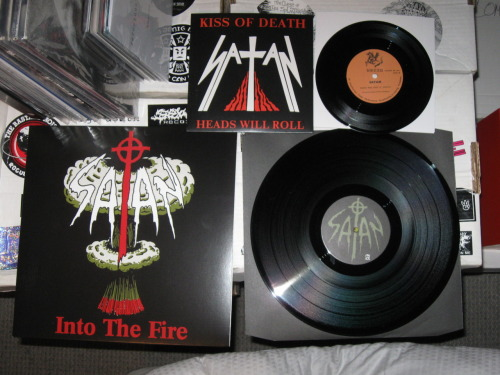 "Satan - ""Into The Fire w/ Kiss Of Death 7"" (Buried By Time And Dust 2011) Who knew metal would get so big that old demos where going to be rereleased 30+ years after they were recorded? I'm sure Satan didn't.  But here we are.  Awesome NWOBHM stuff here.  Comes with an awesome booklet to look at while you are listening."