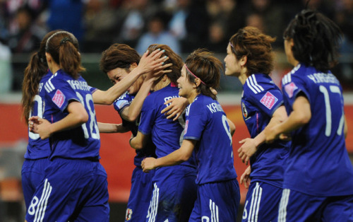 Japan's midfielder Aya Miyama (C) celebrates scoring the 1-1 goal with her teammates during the FIFA Women's Football World Cup final (via Yahoo! Sports Photos)