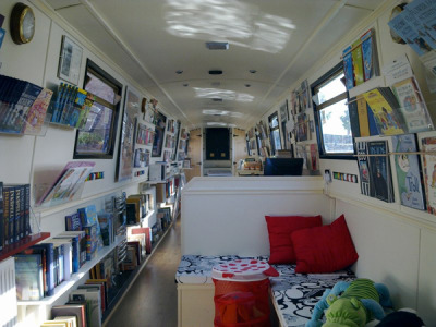 "Step aboard the Book Barge, a floating bookshop on a canal boat that roams the UK waterways at roaring speeds of 4 miles per hour (though its usual mooring is in Staffordshire). Owner Sarah Henshaw, inspired in part by the slow food movement, explains, ""we hope to promote a less hurried and harried lifestyle of idle pleasures, cups of tea, conversation, culture and, of course, curling up with an incomparably good Book Barge purchase… I hoped that by creating a unique retail space, customers would realise how independent bookshops can offer a far more pleasurable shopping experience than they're likely to find online or on the discount shelves at supermarkets."" Books on a boat? A barge, no less? We're sold based on the alliteration alone."
