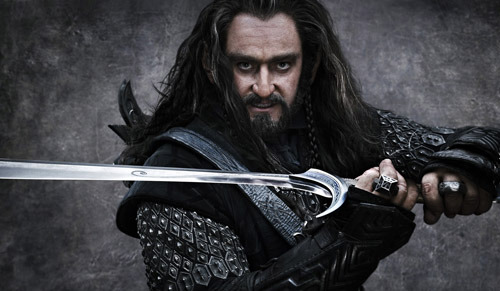 totalfilm:  See Richard Armitage as Thorin Oakenshield in The Hobbit Dwarves are popping out of the woodwork all over the place at the moment. And today is no different, as another short fella from The Hobbit has been revealed online. This time it's Richard Armitage as Thorin Oakenshield, a fearsome leader of dwarves. Oakenshield's backstory is intimately tied to that of giant dragon Smaug, who destroyed the dwarf kingdom of Erebor and slaughtered many of his kin. Continuing the shaggy-haired look of the dwaves, Armitage looks nothing short of fearsome as Oakenshield.