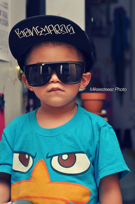 "He wears sunglasses… like a boss! No matter how old or young you are (or feel) make sure to wear your sunglasses ""like a boss.""  Can we agree though, that kids are adorable in sunglasses? Look at Nicole Richie's son, Sparrow!!!  He's adorable! But don't forget stylish.  Sparrow's rocking some sweet red shades! I love bright colors and he looks perfect walking with his mommy! Or Suri Cruise! She's destined to be super stylish and a soon-to-be fashion star! Just take a look!  Cute, right? I love kids' sunglasses because they always come in cool colors with fun patterns! I'm just jealous that I can't wear these now because if I could I would.   I love these blue frames from UrbanSpecs! They are super fun for any kid! Of course they are a little girly and so are the ones below ↓  UrbanSpecs Kids Ella: $6.29!!! They're on sale!  I would never wear these but they are fun! And they kind of remind me of that Lady Gaga video….  Anyway…You can find all these at Eyesave.com! It's summer! Let the kids live a little!"