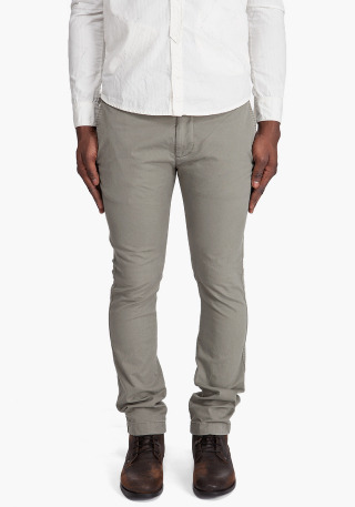 Chi tight Chinos by Diesel. Tight slightly tapered chinos in green stretch gabardine. Slash pockets at sides. Seam coin pocket at front. Button welt pockets at rear. Copper tone logo hardware at Single canvas front belt loop. Button tabs and gold tone logo hardware at rear. Tone on tone stitching. Zip fly with two metal rivets at hook and bar closure.More…