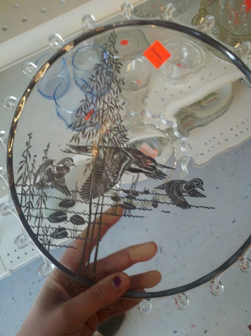 neat glass trivet with birds in silver found at goodwill