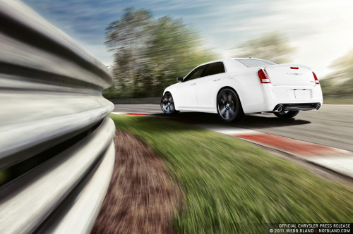 VIDEO:  2012 Chrysler 300 SRT8 VS.  2012 Dodge Charger SRT8.     Reviewers and Jim Wilder, the Development Manager for the 2012 Chrysler 300 SRT8 and the 2012 Charger SRT8,  take the two power hungry cars out for a test spin. Reviewers can't get enough of the high horse power, torque and motor in the Charger.  However, the 300 also packs a lot of punch in a sleek and refined package.  Click the image or the link provided below to watch the video and decide for yourself – the winner of this road challenge. http://blip.tv/tflcarcom/track-time-2012-chrysler-300-srt8-vs-2012-dodge-charger-srt8-5383963