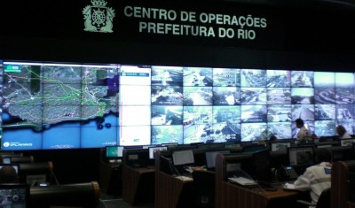 "How Data is Making Rio de Janeiro a Smarter City - TNW Latin America Do you plan to attend 2014 FIFA World Cup or 2016 Olympic Games in Rio de Janeiro? If so, the city is already getting ready to welcome  you. Here is how Rio is using technology and data management to get  smarter. Manage information to avoid tragedies In April 2010, the State of Rio de Janeiro was hit by a natural disaster, when floods and mudslides killed over 200 people and made 15,000 homeless. Worse, Rio de Janeiro's Mayor admitted that Rio's preparedness was ""less than zero"". To avoid similar  tragedies, the city had until the next rainy season to prepare. This led  to the creation of Rio Operations Center in partnership with IBM. It opened its doors on December 31st 2010, only a few months after the catastrophe. Rio Operations Center, the city's control room Although its initial focus was floods, the scope of Rio Operations  Center expanded considerably. Beyond managing all emergency response  situations, it's also the city's information management center. It  monitors transportation, water, weather and energy 24/7, 365 days a  year. The Center is part of the Smarter Cities initiative that IBM has been promoting since 2007. The group, which celebrated its 100th anniversary in June, has  launched similar projects in cities such as New York City or Gauteng in  South Africa. However, Rio is its most ambitious initiative to date, as  part of the major transformations the city is going through ahead of the World Cup and Olympics."