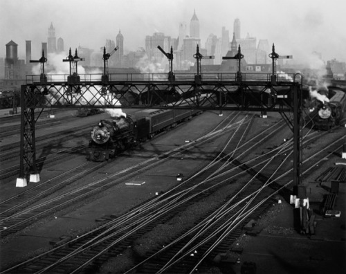 Hoboken railroads and New York's skyline, by Berenice Abbot. From Thinking Berenice Abbott, July 17 1898 (via)