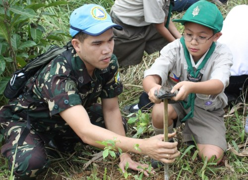 Soldier and Boy Scout plant trees for the Next Generation