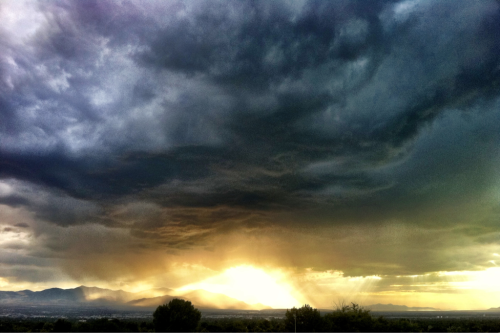 "Utah Landscapes 1 ""Light After Storm"" - Salt Lake City, UT  iPhone 4, Camera+  I was driving home from downtown and the sun dipped below the clouds in the final moments of sunset. I was in a spot where I could see the city and the sky start to shine. I pulled over and took this shot on an overpass with trucks and cars zooming past me. A small squall was moving across the valley and the sun lit the raindrops and made the world glow for a brief few moments.  I offer this image as a print on fine art paper. The final result looks more like a painting than a photo. It is one of my favorites and I never grow tired of it."