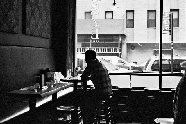 Black and White Bars: Sitting alone, waiting for a friend.