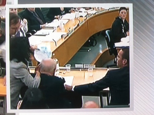PHOTO: Rupert Murdoch gets pied w/ shaving cream (?) at a UK parliamentary hearing.