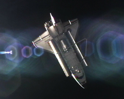 Image above: Space shuttle Atlantis is seen from the International Space Station shortly after undocking. Photo credit: NASA TV