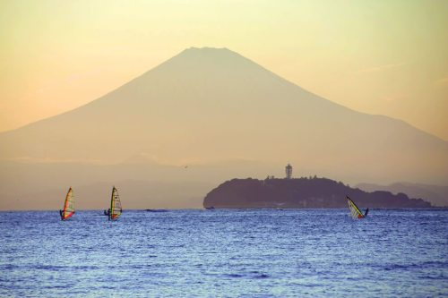 Mt.Fuji in the background and resort tidal island of Enoshima, Japan, at high tide.
