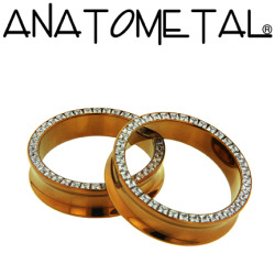 anatometal:  Princess Eyelets in ASTM F-136 titanium, anodized bronze; CZ gemstones