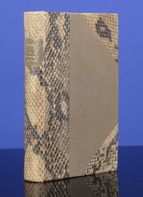 Snakes F.W. Fitzsimons. London: Hutchinson & Co., [1932] Bound by Sangorski & Sutcliffe  First edition.  .Written by F.W. Fitzsimons, Director of the Port Elizabeth Museum and Snake Park. With 44 Illustrations A unique copy, specially bound (ca. 1975) by Sangorski & Sutcliffe (stamp-signed in gilt on the front turn-in) in three-quarter gray and black snakeskin over gray morocco boards. Smooth spine with gray morocco gilt lettering label and with date stamped in gilt at foot of spine. All edges gilt.