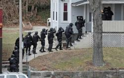 SWAT Reporting Bill Filed In Michigan | Drug War Chronicle  A bill that would impose reporting requirements on law enforcement SWAT teams has been introduced in the Michigan House. The bill, House Bill 4857, would require those specialized paramilitary units to file a report when they forcibly enter a home, discharge a weapon, or injure or kill a suspect. The sponsor, Rep. Tom McMillin (R-Rochester Hills) told the instate Livingston Daily he introduced the bill in part because of concerns stemming from a May 2010 Detroit police SWAT raid in which police shot and killed 7-year-old Aiyanna Jones. He said he was most concerned about the lack of information from SWAT teams, which use automatic weapons and grenades, as well as kicking down doors. […] The only other state to impose reporting requirements on SWAT teams is Maryland. That law passed only after a Prince Georges County SWAT team made the mistake of practicing its usual tactics on the mayor or Berwyn Heights, who was both innocent of any wrongdoing and in a position to be able to right the wrong inflicted on him. +